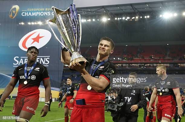 Owen Farrell of Saracens celebrates with the trophy after the European Rugby Champions Cup Final match between Racing 92 and Saracens at the Stade de...