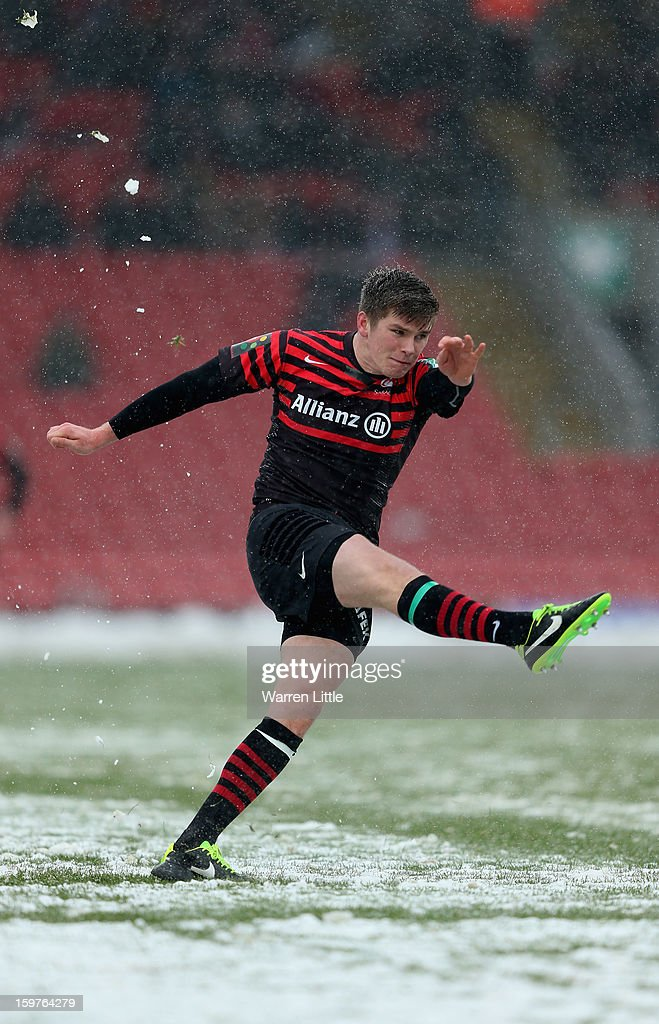 <a gi-track='captionPersonalityLinkClicked' href=/galleries/search?phrase=Owen+Farrell&family=editorial&specificpeople=4809668 ng-click='$event.stopPropagation()'>Owen Farrell</a> of Saracens converts a kick at goal during the Heineken Cup match between Saracens and Edinburgh Rugby at Vicarage Road on January 20, 2013 in Watford, England.