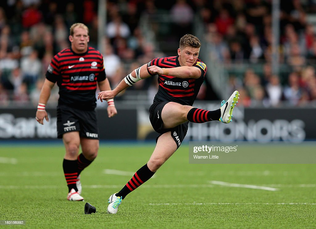 <a gi-track='captionPersonalityLinkClicked' href=/galleries/search?phrase=Owen+Farrell&family=editorial&specificpeople=4809668 ng-click='$event.stopPropagation()'>Owen Farrell</a> of Saracens converts a penalty during the Aviva Premiership match between Saracens and London Wasps at Allianz Park on October 5, 2013 in Barnet, England.