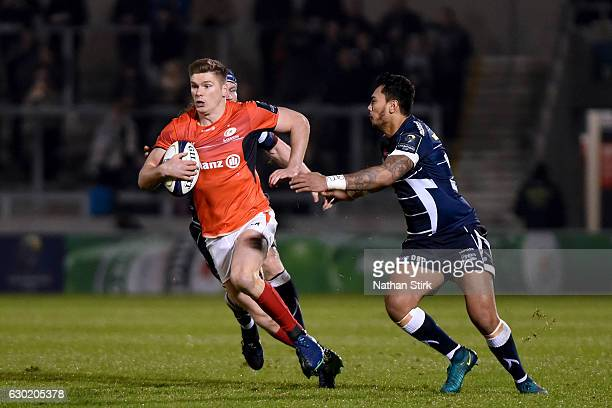 Owen Farrell of Saracens gets away from Denny Solomona of Sale Sharks during the European Rugby Champions Cup match between Sale Sharks and Saracens...