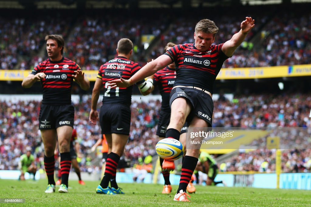<a gi-track='captionPersonalityLinkClicked' href=/galleries/search?phrase=Owen+Farrell&family=editorial&specificpeople=4809668 ng-click='$event.stopPropagation()'>Owen Farrell</a> of Saracens injures himself as he kicks the ball in celebration of a try that was later disallowed during the Aviva Premiership Final between Saracens and Northampton Saints at Twickenham Stadium on May 31, 2014 in London, England.
