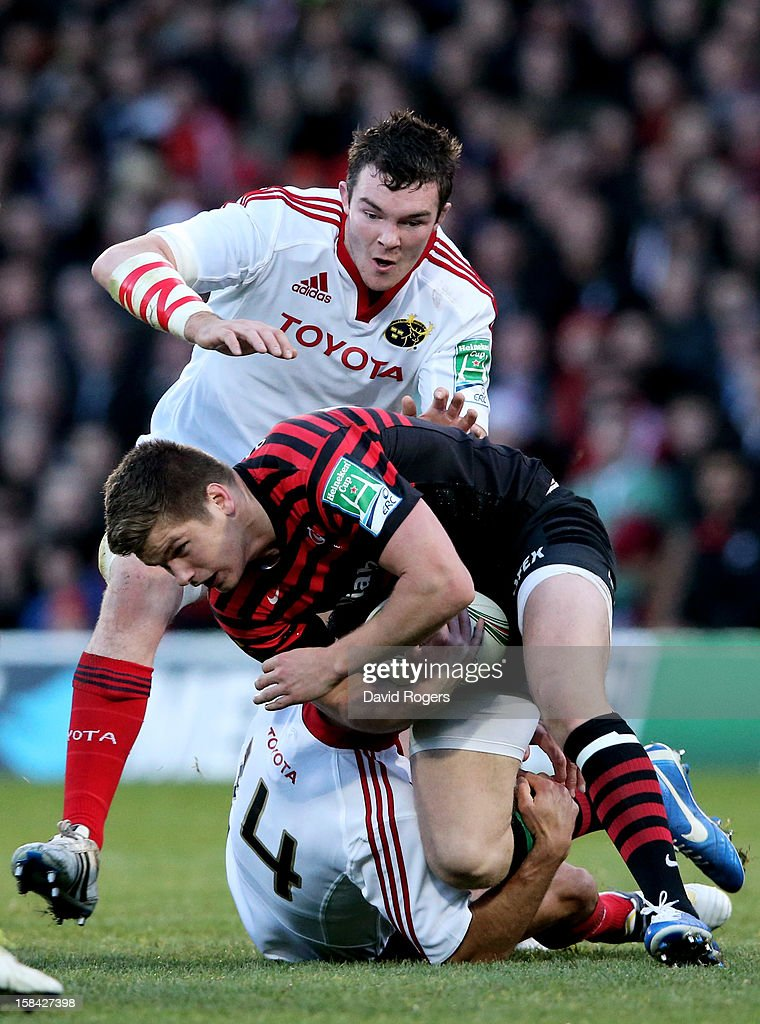 <a gi-track='captionPersonalityLinkClicked' href=/galleries/search?phrase=Owen+Farrell&family=editorial&specificpeople=4809668 ng-click='$event.stopPropagation()'>Owen Farrell</a> of Saracens is brought down by Simon Zebo and Donnacha Ryan of Munster during the Heineken Cup pool one match between Saracens and Munster at Vicarage Road on December 16, 2012 in Watford, United Kingdom.