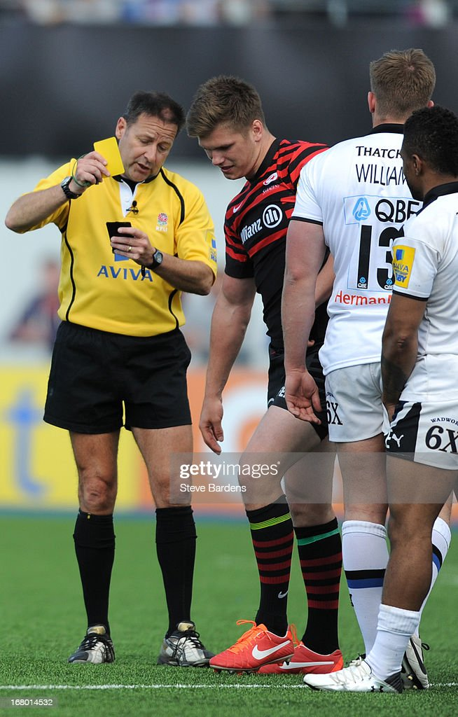 <a gi-track='captionPersonalityLinkClicked' href=/galleries/search?phrase=Owen+Farrell&family=editorial&specificpeople=4809668 ng-click='$event.stopPropagation()'>Owen Farrell</a> of Saracens is shown a yellow card by the Referee Martin Fox after catching Tom Heathcote of Bath with a high tackle during the Aviva Premiership match between Saracens and Bath at Allianz Park on May 04, 2013 in Barnet, England.