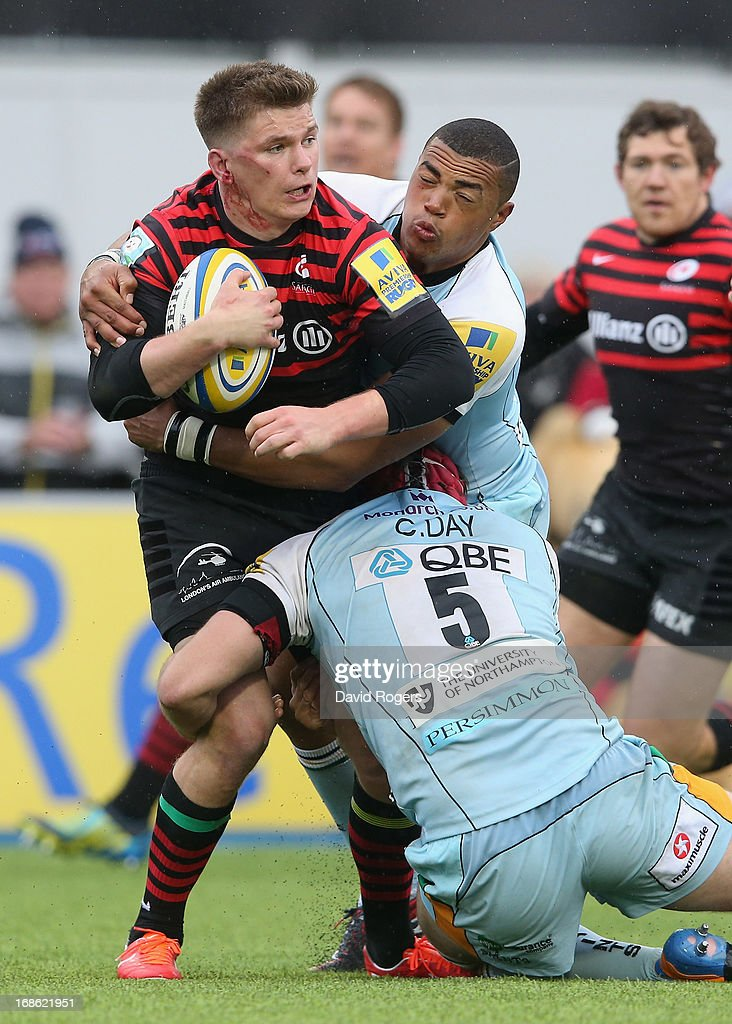 <a gi-track='captionPersonalityLinkClicked' href=/galleries/search?phrase=Owen+Farrell&family=editorial&specificpeople=4809668 ng-click='$event.stopPropagation()'>Owen Farrell</a> of Saracens is tackled by <a gi-track='captionPersonalityLinkClicked' href=/galleries/search?phrase=Luther+Burrell&family=editorial&specificpeople=871965 ng-click='$event.stopPropagation()'>Luther Burrell</a> and Christian Day during the Aviva Premiership semi final match between Saracens and Northampton Saints at Allianz Park on May 12, 2013 in Barnet, England.