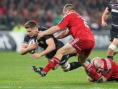 Owen Farrell of Saracens is tackled by Paul O'OConnell and Duncan Casey during the European Rugby Champions Cup match between Munster and Saracens at...