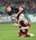 Owen Farrell of Saracens is tackled by Paul O'OConnell during the European Rugby Champions Cup match between Munster and Saracens at Thomond Park on...