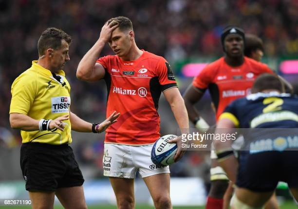 Owen Farrell of Saracens remonstrates with Referee Nigel Owens of Wales during the European Rugby Champions Cup Final between ASM Clermont Auvergne...