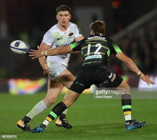 Owen Farrell of Saracens takes on Piers Francis during the European Rugby Champions Cup match between Northampton Saints and Saracens at Franklin's...