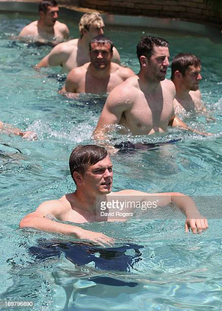 Owen Farrell of the British and Irish Lions leads his team mates as they take part in a recovery session at the Grand Hyatt Hotel on June 2 2013 in...