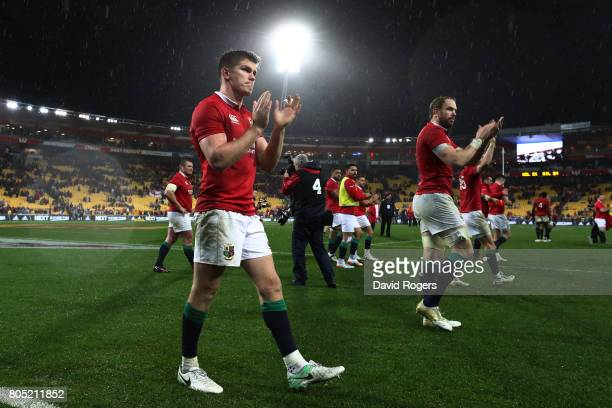 Owen Farrell of the Lions and teammates celebrates following their team's 2421 victory during the second test match between the New Zealand All...