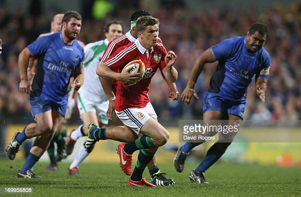 Owen Farrell of the Lions breaks clear to score a try during the tour match between the Western Force and the British Irish Lions at Patersons...