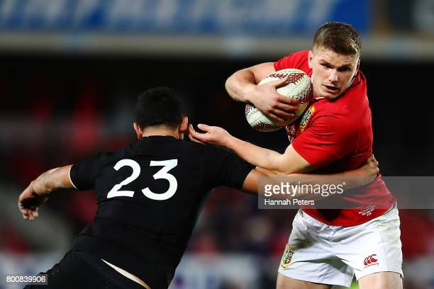 Owen Farrell of the Lions charges forward during the Test match between the New Zealand All Blacks and the British Irish Lions at Eden Park on June...