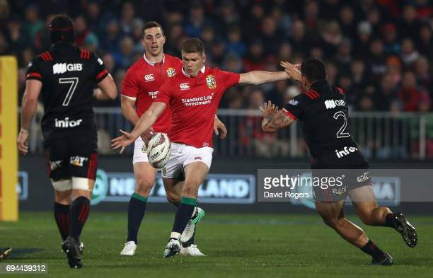 Owen Farrell of the Lions kicks the ball past Matt Todd and Codie Taylor during the match between the Crusaders and the British Irish Lions at AMI...