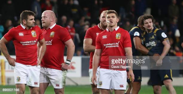 Owen Farrell of the Lions looks dejected with team mates after their defeat during the 2017 British Irish Lions tour match between the Highlanders...