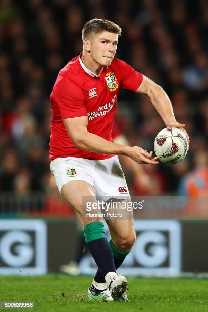 Owen Farrell of the Lions looks to pass the ball out during the Test match between the New Zealand All Blacks and the British Irish Lions at Eden...