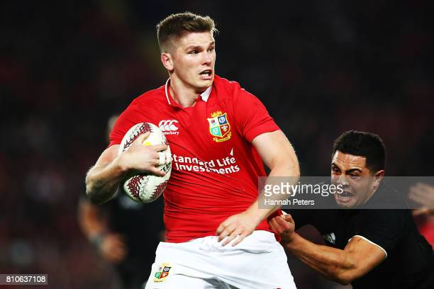 Owen Farrell of the Lions makes a brea during the Test match between the New Zealand All Blacks and the British Irish Lions at Eden Park on July 8...