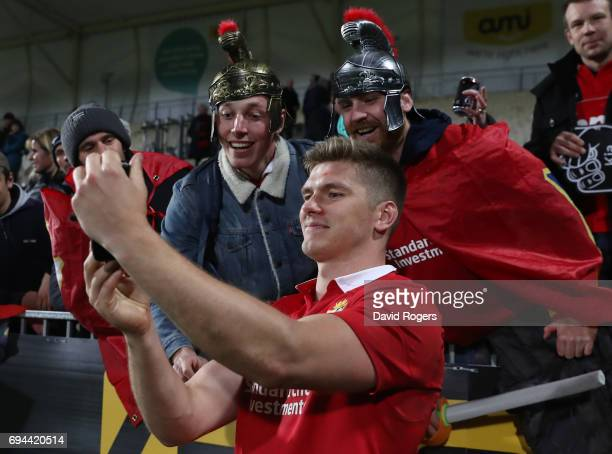 Owen Farrell of the Lions poses for a photo with Lions fans following their team's123 victory during the 2017 British Irish Lions tour match between...