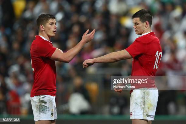 Owen Farrell of the Lions speaks with Johnny Sexton of the Lions during the second test match between the New Zealand All Blacks and the British...