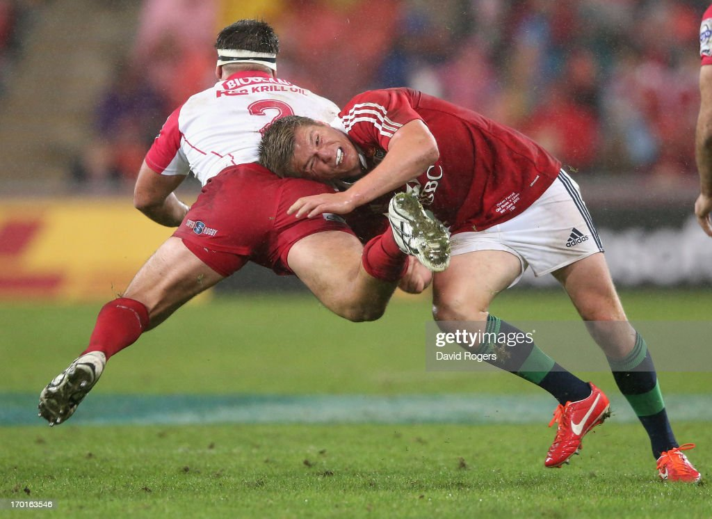 <a gi-track='captionPersonalityLinkClicked' href=/galleries/search?phrase=Owen+Farrell&family=editorial&specificpeople=4809668 ng-click='$event.stopPropagation()'>Owen Farrell</a> of the Lions tackles James Hanson during the match between the Queensland Reds and the British & Irish Lions at Suncorp Stadium on June 8, 2013 in Brisbane, Australia.