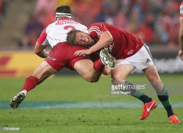 Owen Farrell of the Lions tackles James Hanson during the match between the Queensland Reds and the British Irish Lions at Suncorp Stadium on June 8...