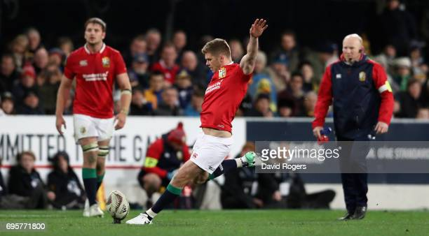 Owen Farrell of the Lions takes a penalty watched by kicking coach Neil Jenkins during the 2017 British Irish Lions tour match between the...