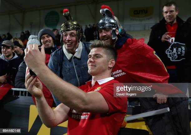 Owen Farrell of the Lions takes a selfie with fans during the match between the Crusaders and the British Irish Lions at AMI Stadium on June 10 2017...