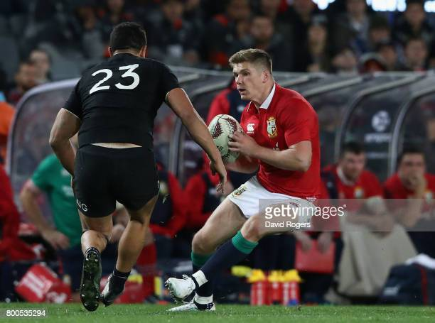 Owen Farrell of the Lions takes on Anton LienertBrown during the Test match between the New Zealand All Blacks and the British Irish Lions at Eden...