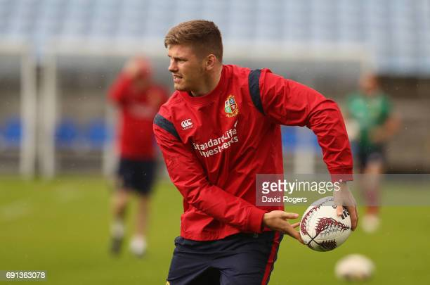 Owen Farrell passes the ball during the British Irish Lions training session at Toll Stadium on June 2 2017 in Whangarei New Zealand