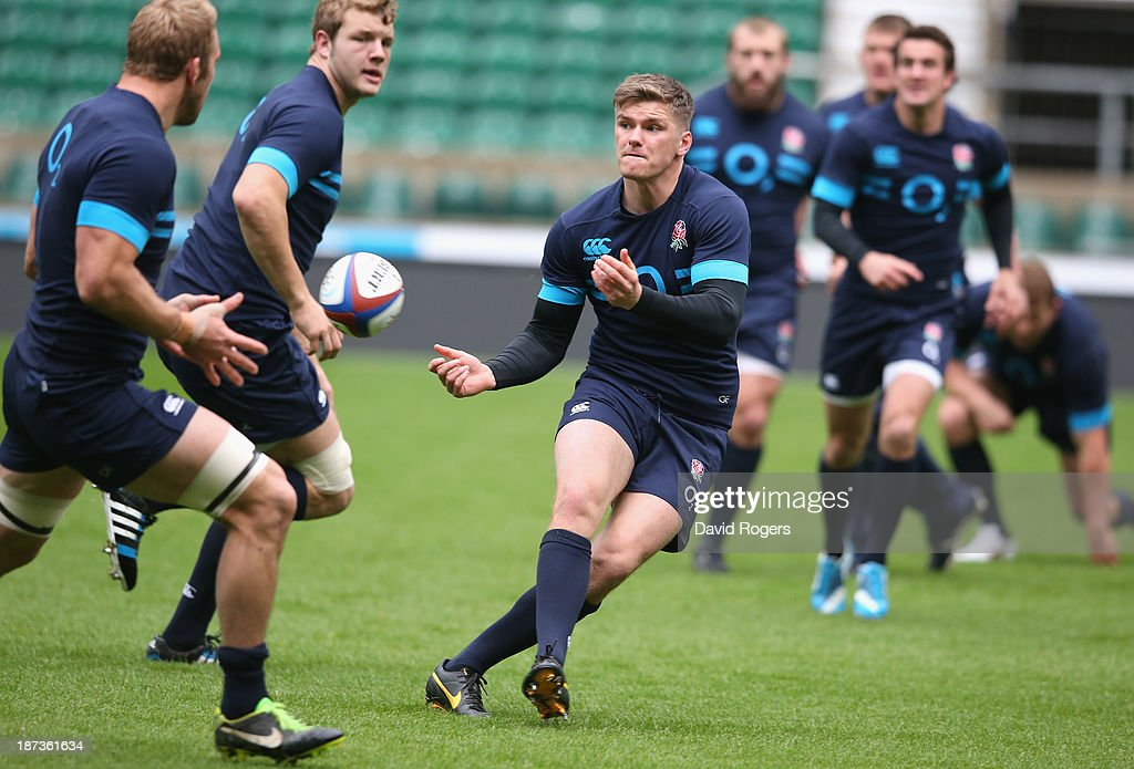 <a gi-track='captionPersonalityLinkClicked' href=/galleries/search?phrase=Owen+Farrell&family=editorial&specificpeople=4809668 ng-click='$event.stopPropagation()'>Owen Farrell</a> passes the ball during the England captain's run at Twickenham Stadium on November 8, 2013 in London, England.