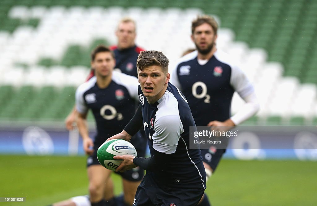 <a gi-track='captionPersonalityLinkClicked' href=/galleries/search?phrase=Owen+Farrell&family=editorial&specificpeople=4809668 ng-click='$event.stopPropagation()'>Owen Farrell</a> passes the ball during the England captain's run at the Aviva Stadium on February 9, 2013 in Dublin, Ireland.
