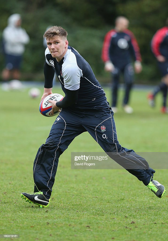Owen Farrell passes the ball during the England training session at Pennyhill Park on January 29, 2013 in Bagshot, England.