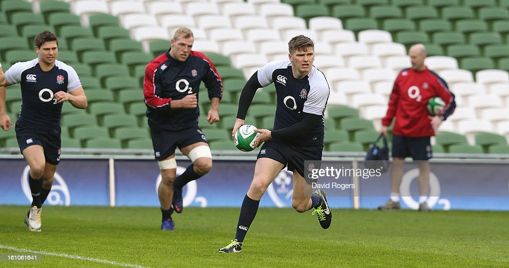 <a gi-track='captionPersonalityLinkClicked' href=/galleries/search?phrase=Owen+Farrell&family=editorial&specificpeople=4809668 ng-click='$event.stopPropagation()'>Owen Farrell</a> runs with the ball during the England captain's run at the Aviva Stadium on February 9, 2013 in Dublin, Ireland.