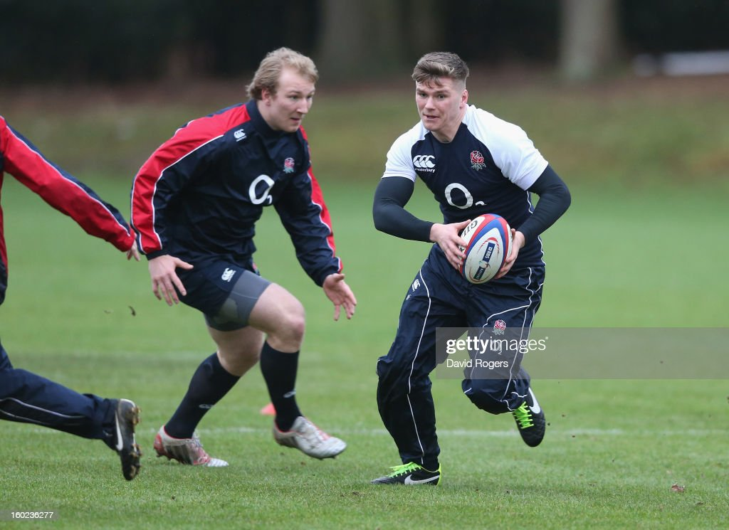 Owen Farrell runs with the ball during the England training session held at Pennyhill Park on January 28, 2013 in Bagshot, England.