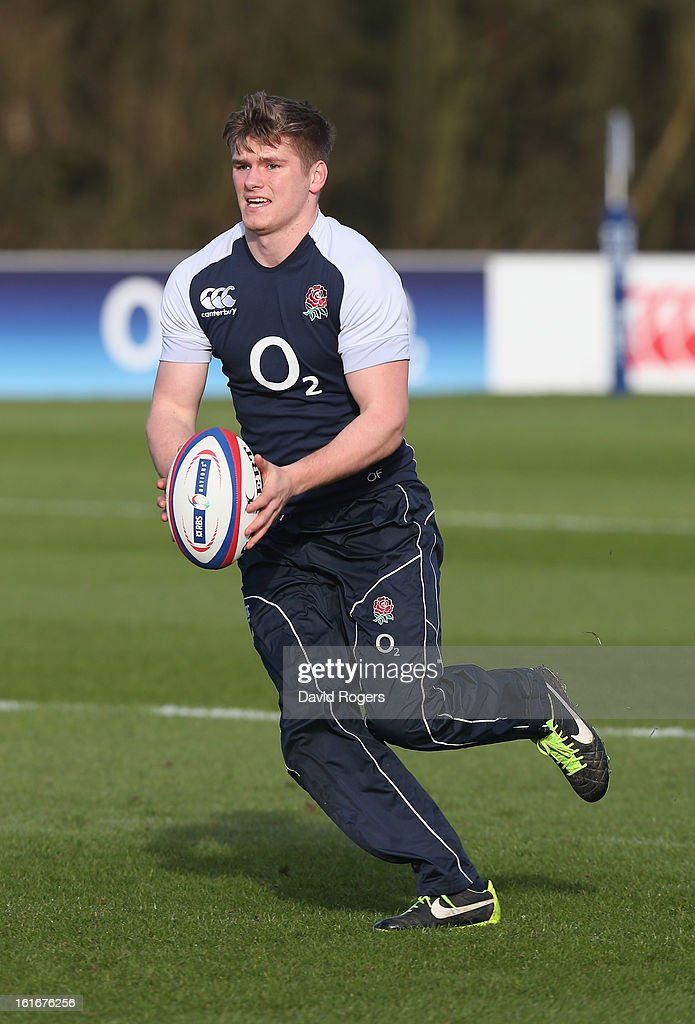 <a gi-track='captionPersonalityLinkClicked' href=/galleries/search?phrase=Owen+Farrell&family=editorial&specificpeople=4809668 ng-click='$event.stopPropagation()'>Owen Farrell</a> runs with the ball during the England training session held at St Georges Park on February 14, 2013 in Burton-upon-Trent, England.