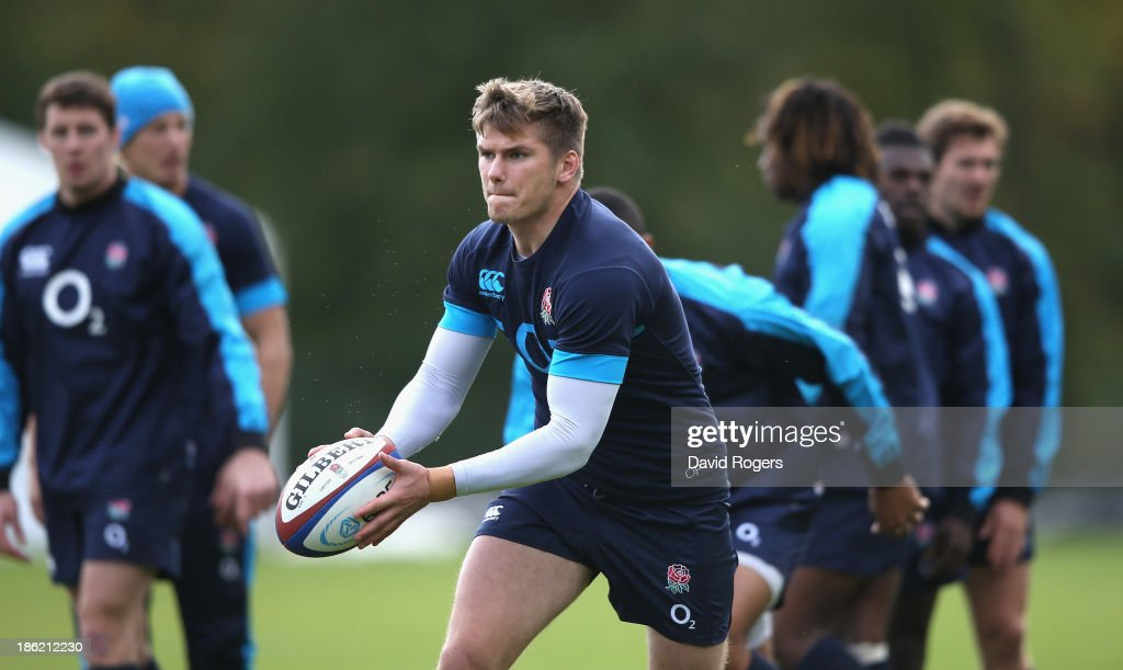 Owen Farrell runs with the ball during the England training session held at Pennyhill Park on October 29, 2013 in Bagshot, England.