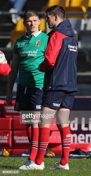 Owen Farrell talks to Jonathan Sexton during the British Irish Lions training session at Porirua Park on June 29 2017 in Wellington New Zealand
