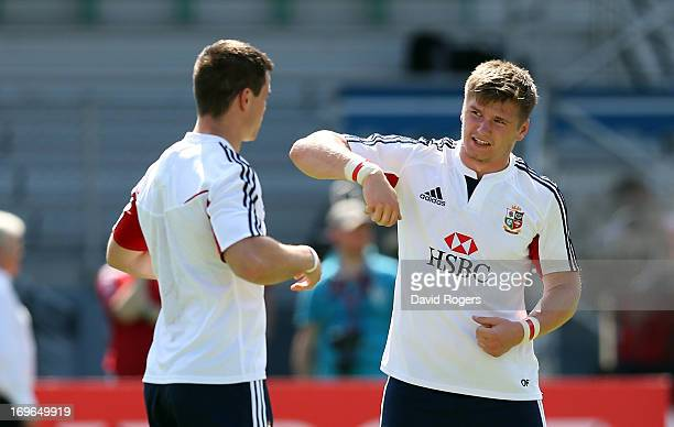 Owen Farrell talks to Jonny Sexton during the British and Irish Lions training session held at the Aberdeen Sports Stadium May 30 2013 in Hong Kong