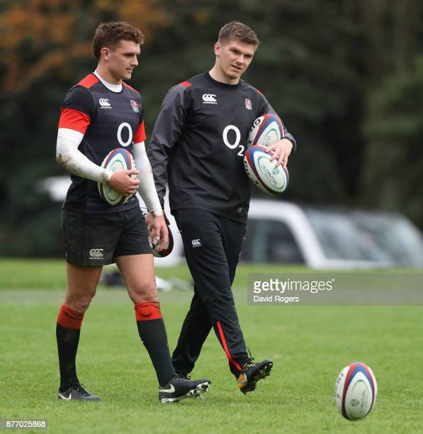 Owen Farrell talks to team mate Henry Slade during the England training session held at Pennyhill Park on November 21 2017 in Bagshot England