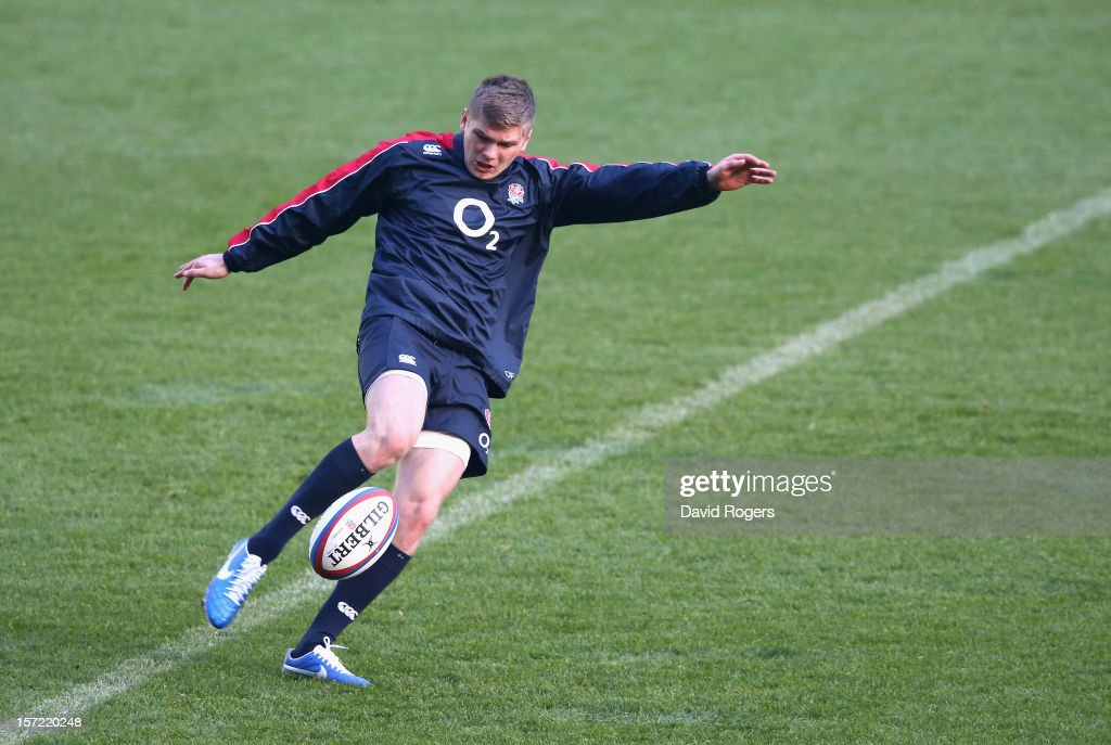 Owen Farrell, the England standoff, kicks the ball upfield during the England captain's run at Twickenham Stadium on November 30, 2012 in London, England.