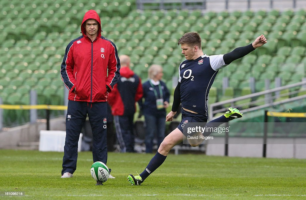 <a gi-track='captionPersonalityLinkClicked' href=/galleries/search?phrase=Owen+Farrell&family=editorial&specificpeople=4809668 ng-click='$event.stopPropagation()'>Owen Farrell</a>, the England standoff, practices his kicking watched by his father and England backs coach <a gi-track='captionPersonalityLinkClicked' href=/galleries/search?phrase=Andy+Farrell+-+Rugby+Coach&family=editorial&specificpeople=234823 ng-click='$event.stopPropagation()'>Andy Farrell</a> during the England captain's run at the Aviva Stadium on February 9, 2013 in Dublin, Ireland.