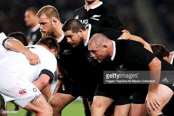 Owen Franks Dane Coles and Tony Woodcock of New Zealand pack down in a scrum during the International Test Match between the New Zealand All Blacks...