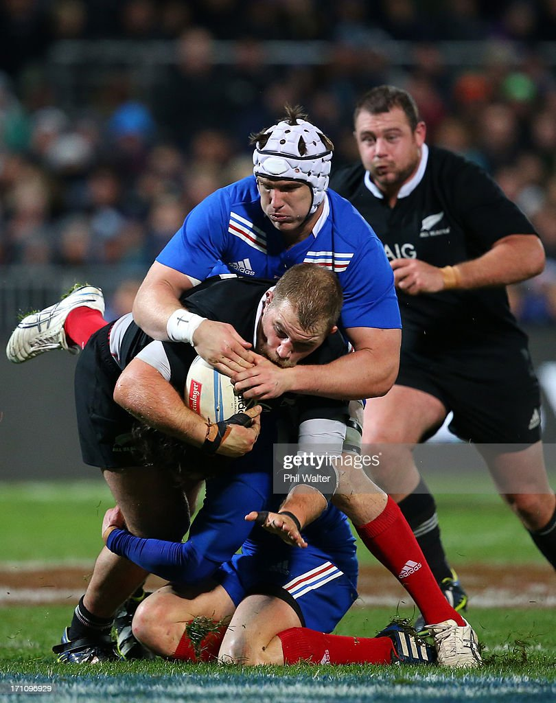 <a gi-track='captionPersonalityLinkClicked' href=/galleries/search?phrase=Owen+Franks+-+Rugby+Player&family=editorial&specificpeople=5509808 ng-click='$event.stopPropagation()'>Owen Franks</a> is tackled by Bernard Le Roux of France during the Third Test Match between the New Zealand All Blacks and France at Yarrow Stadium on June 22, 2013 in New Plymouth, New Zealand.
