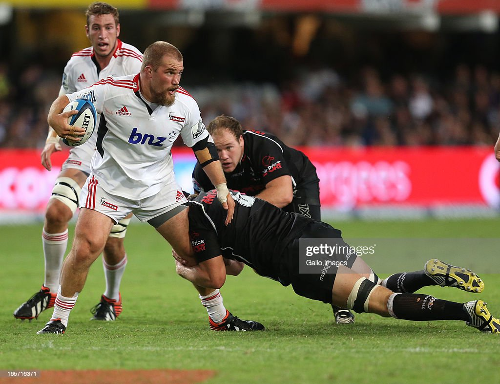 Owen Franks of Crusaders is tackled during the Super Rugby round eight match between the Sharks and Crusaders from Kings Park on April 05, 2013 in Durban, South Africa.