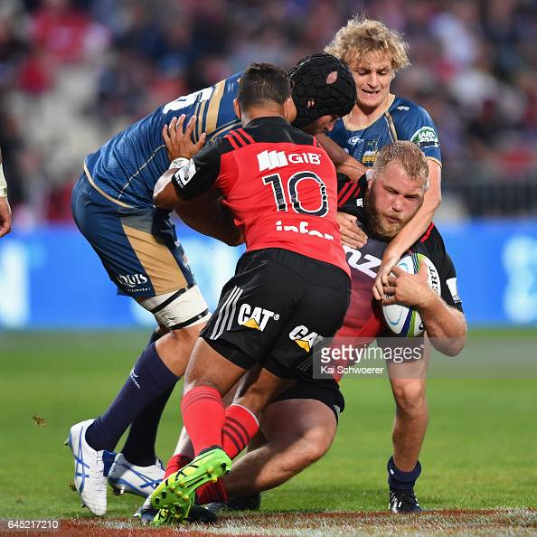 Owen Franks of the Crusaders is tackled during the round one Super Rugby match between the Crusaders and the Brumbies at AMI Stadium on February 25...