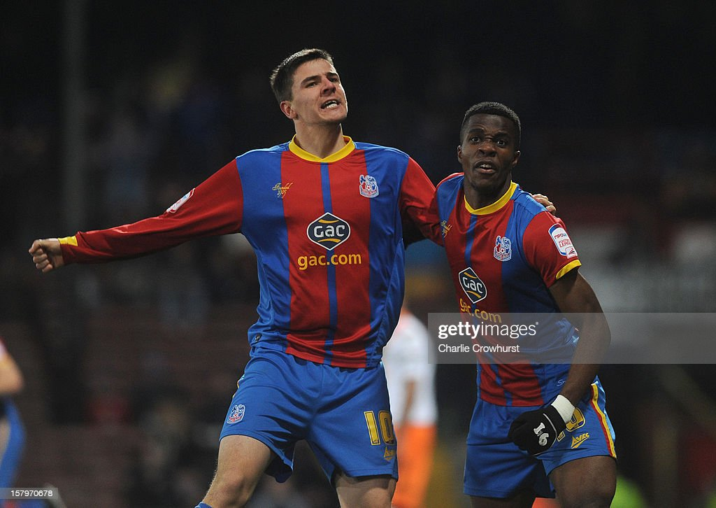<a gi-track='captionPersonalityLinkClicked' href=/galleries/search?phrase=Owen+Garvan&family=editorial&specificpeople=786029 ng-click='$event.stopPropagation()'>Owen Garvan</a> of Crystal Palace celebrates his goal with <a gi-track='captionPersonalityLinkClicked' href=/galleries/search?phrase=Wilfried+Zaha&family=editorial&specificpeople=7132531 ng-click='$event.stopPropagation()'>Wilfried Zaha</a> during the npower Championship match between Crystal Palace and Blackpool at Selhurt Park on December 08, 2012 in London, England.