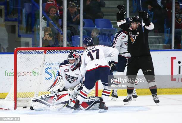 Owen Hardy of the Vancouver Giants celebrates his goal against goaltender Beck Warm of the TriCity Americans during the third period of their WHL...
