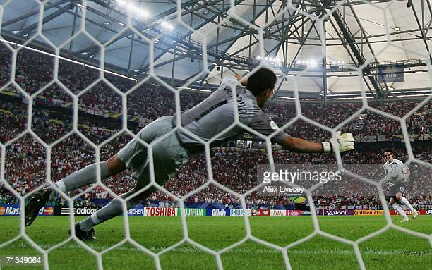 Owen Hargreaves of England scores a penalty past Ricardo of Portugal in a penalty shootout during the FIFA World Cup Germany 2006 Quarterfinal match...