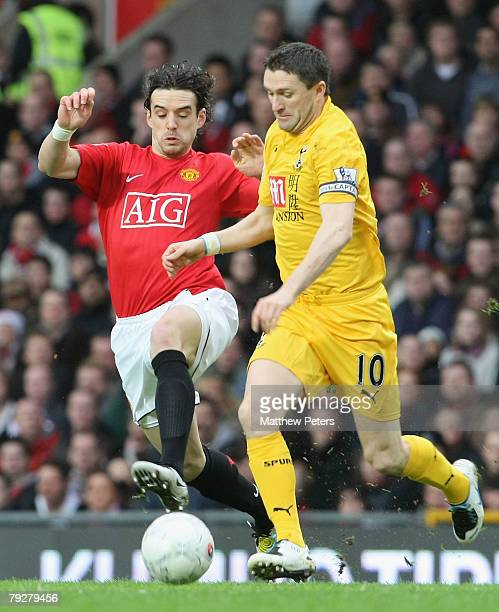 Owen Hargreaves of Manchester United clashes with Robbie Keane of Tottenham Hotspur during the FA Cup sponsored by eon Fourth Round match between...