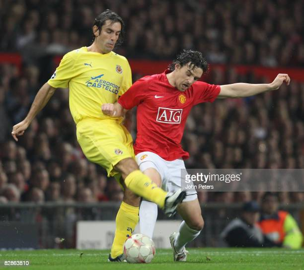 Owen Hargreaves of Manchester United clashes with Robert Pires of Villarreal during the UEFA Champions League match between Manchester United and...