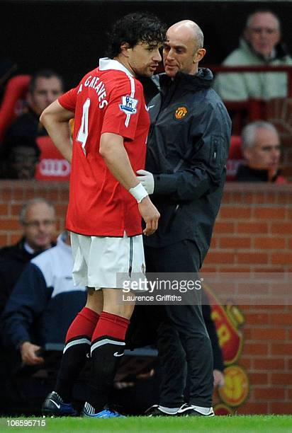 Owen Hargreaves of Manchester United consults with the team physio prior to leaving the pitch with an injury during the Barclays Premier League match...